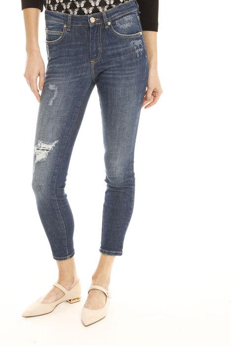 Jeans aderenti con strappo Fashion Market
