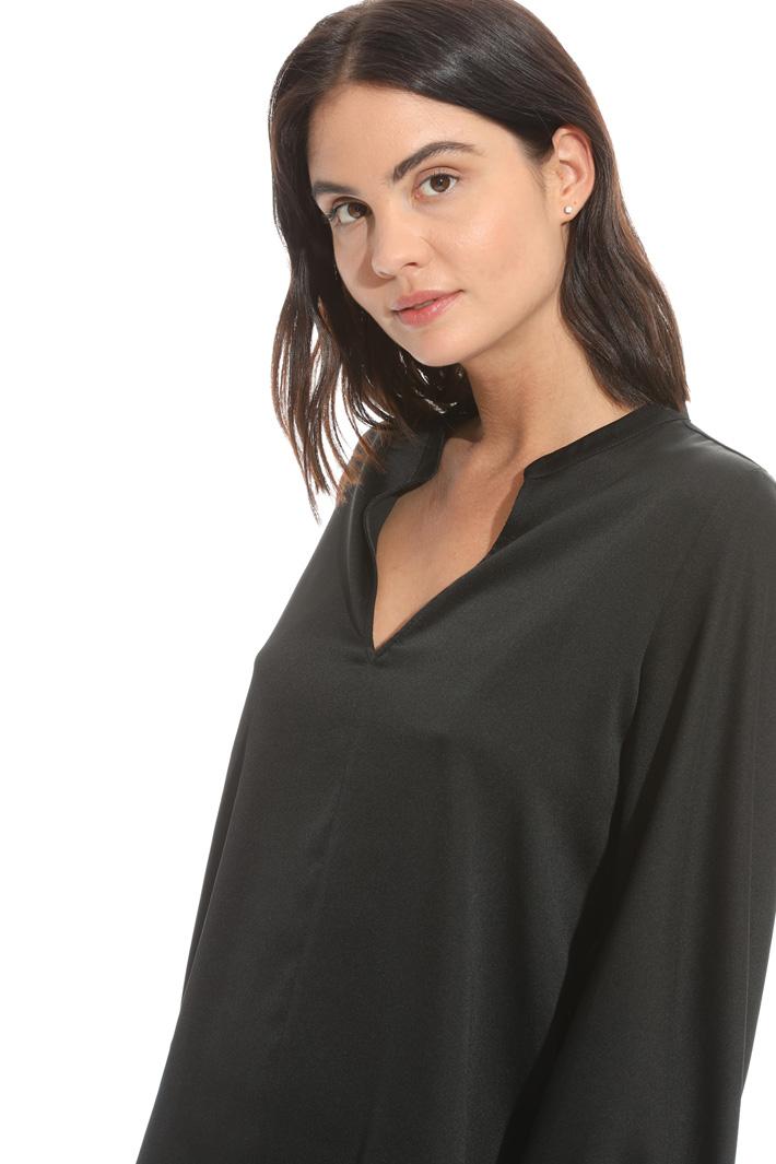 Blusa con polsini punto smock Fashion Market
