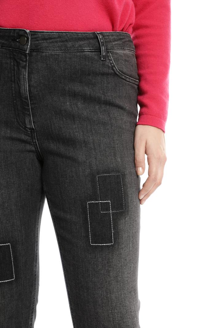 Jeans skinny con impunture Fashion Market